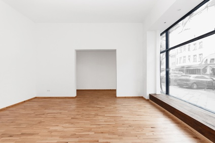 empty room newly renovated - store / shop with wooden floor and
